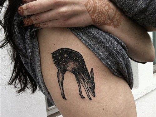 Lovely doe tattoo on ribs for girls