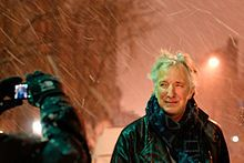 """Alan Rickman posing for a fan under the snow storm. Stage door session after the performance of Ibsen's """"John Gabriel Borkman"""" at the Brooklyn Academy of Music, January 11th 2011."""