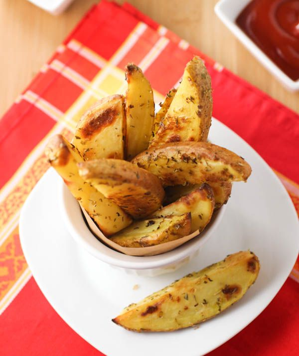 Baked Greek Potatoes roasted with herbs, salt, lemon juice and olive ...