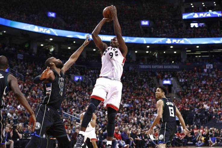 TORONTO, CANADA - APRIL 15:  Serge Ibaka #9 of the Toronto Raptors shoots the ball against the Milwaukee Bucks on April 15, 2017 during Game One of Round One of the 2017 NBA Playoffs at the Air Canada Centre in Toronto, Ontario, Canada.  NOTE TO USER: User expressly acknowledges and agrees that, by downloading and or using this Photograph, user is consenting to the terms and conditions of the Getty Images License Agreement.  Mandatory Copyright Notice: Copyright 2016 NBAE (Photo by Mark…