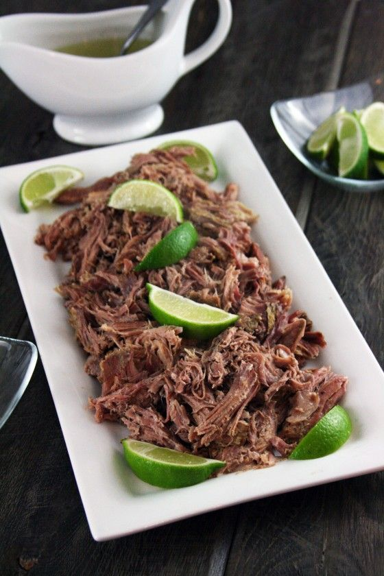 Oh man. Has meat ever looked so sexy?! Crockpot Lechon (Pulled Pork) with Cuban Mojito Sauce by @MyLifeAsAMrs