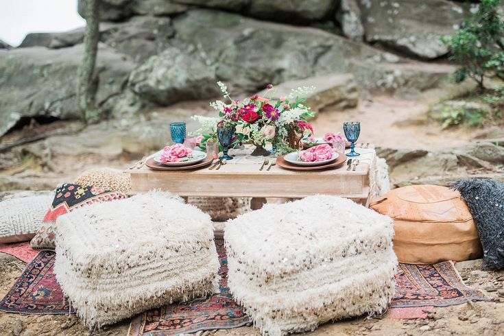 "Maryland Boho Wedding Inspo ft. ""White Trestle Base Table, Dusky Blue Glassware Mix & Nadia Wedding Blanket Poufs"" || Photography: Focus Bay Photography. Planning & Styling: Elle Reaux. Floral: Blush Floral Design Studio. Rentals: White Glove Rentals."
