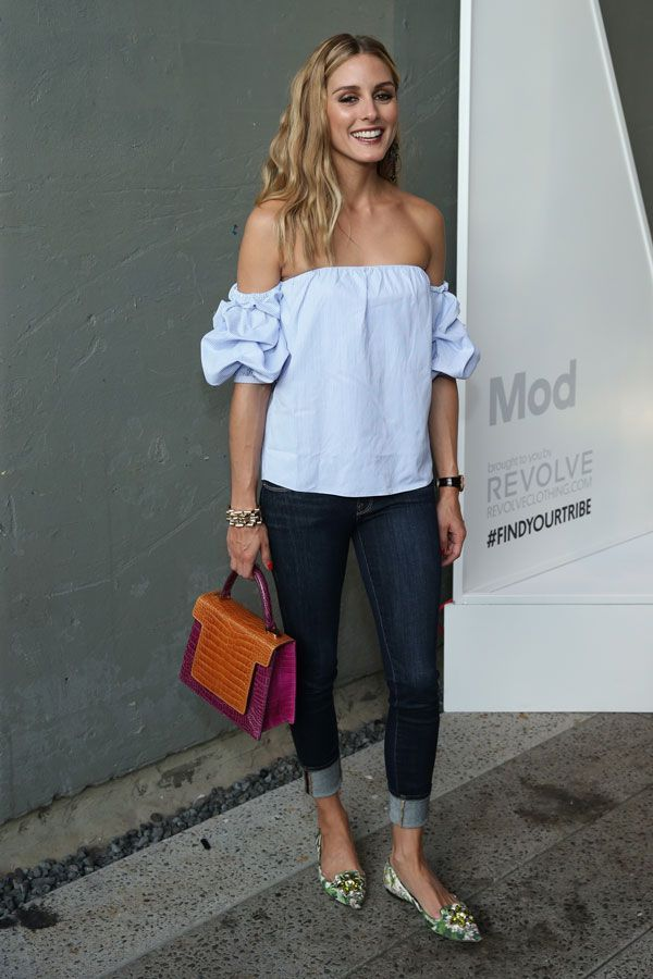 Olivia Palermo in a cute blue off the shoulder top and dark skinnies.