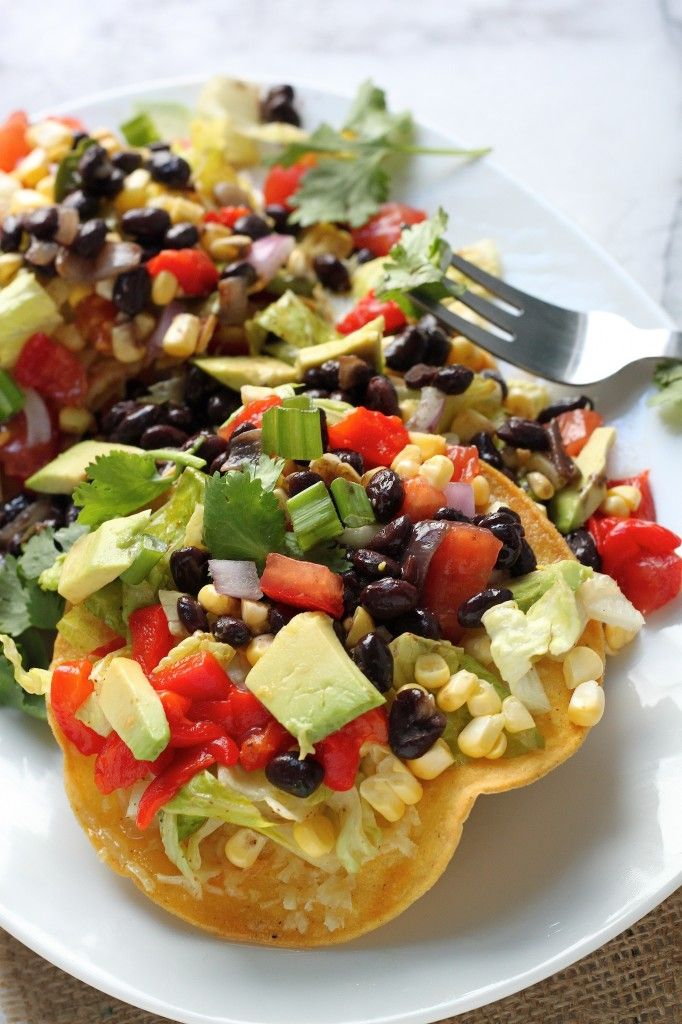 Mexican Chopped Tostada Salad - Crispy corn tortillas topped with tons of veggies and flavor packed black beans! This is a hearty, healthy, flavorful salad you're sure to love!