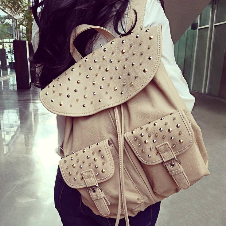 Give your backpack the studded treatment with this glammed-up bag. With gold & silver studs, it easily doubles as a chic all-day grab-and-go. aldoshoes.com