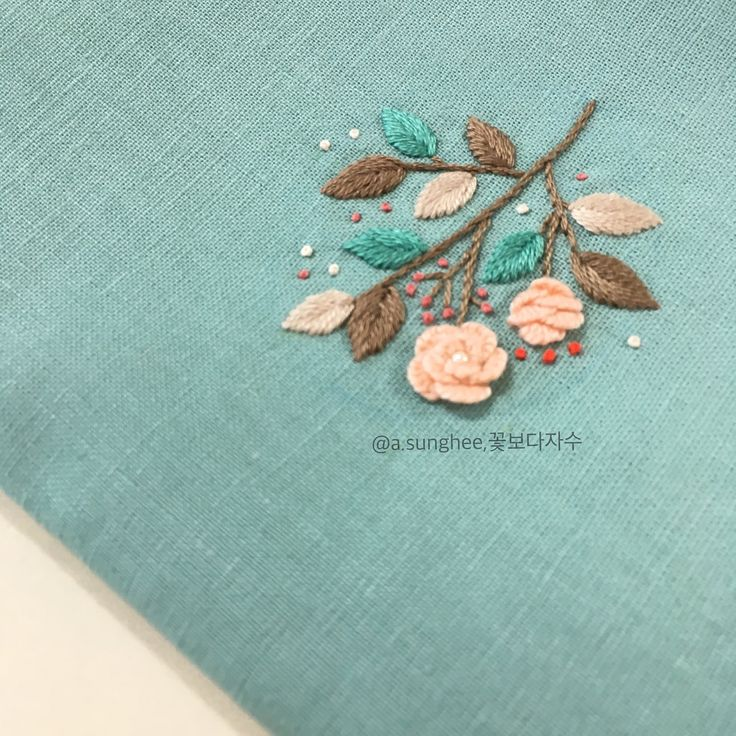 Sweet embroidery on mint linen