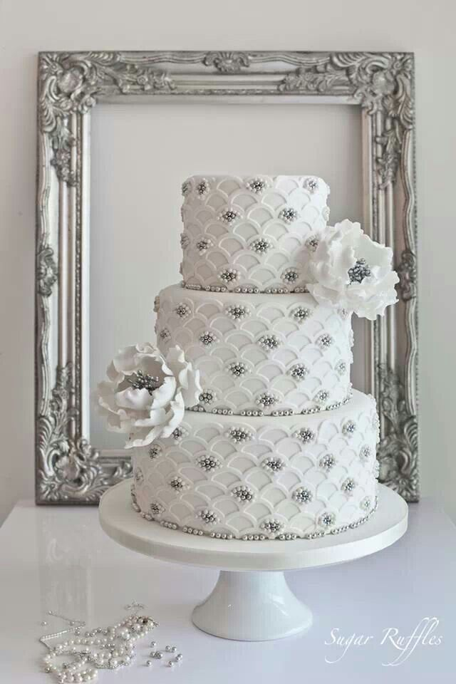 White and silver wedding cake For more great ideas go to www.destinationweddingcollective.com