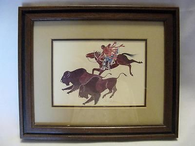 $v40 Native-American-Art-by-Englishman-Paul-Goble-Buffalo-Hunt-Nicely-Framed-Matted  This is a wonderful print by Paul Goble, an Englishman who became fascinated by Native American folk lore and has painted many paintings and written several books for children on the subject.  This print shows a Native American on his horse chasing two buffalo and ready to put an arrow in one of them.  Lots of action in this print.  The outside measurment with frame is 11 1/2 by 9 1/2 inches.