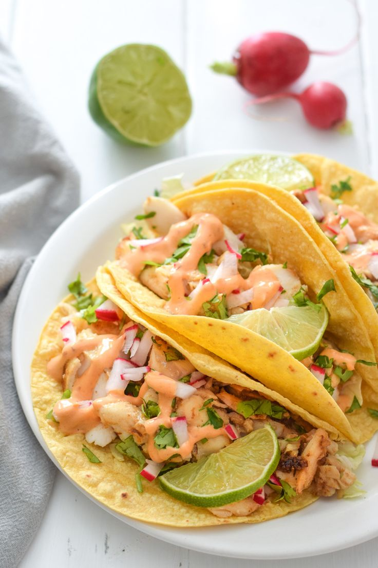 Made with a bright and creamy chipotle lime crema made with greek yogurt (or use coconut milk)  and lime juice, these Fish Tacos take only 15 minutes to make and are gluten free!
