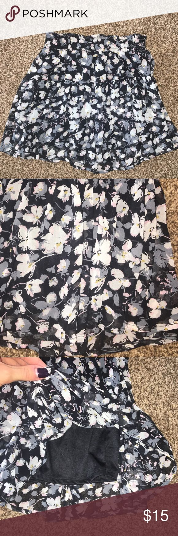 MUST GO Floral Skater Mini Skirt: XS MUST GO SEND ME YOUR LOWEST OFFER!!!  Need  to clear out my closet .  Adorable floral mini skirt!  Mostly black and gray with white/cream and a small amount of muted/light baby pink and gray/blue. Loose/fit and flare/skater syle. Nice chiffon/blouse type fabric. Fully lined (pictured)!  Has a cinched waist band that has a good amount of stretch (could fit XS or Small). Excellent condition looks perfect! Skirts