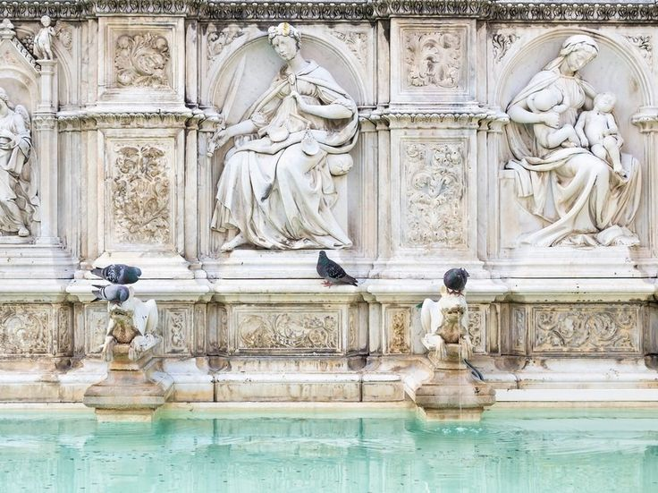 """This impressive fountain is one of the Tuscan town's best, and easiest to spot—it's in the center of Piazza del Campo, the main square and home to Siena's famous horse race, il Palio. Siena itself is filled with architecture-as-art—earning it a UNESCO designation as the """"embodiment of a medieval city."""""""