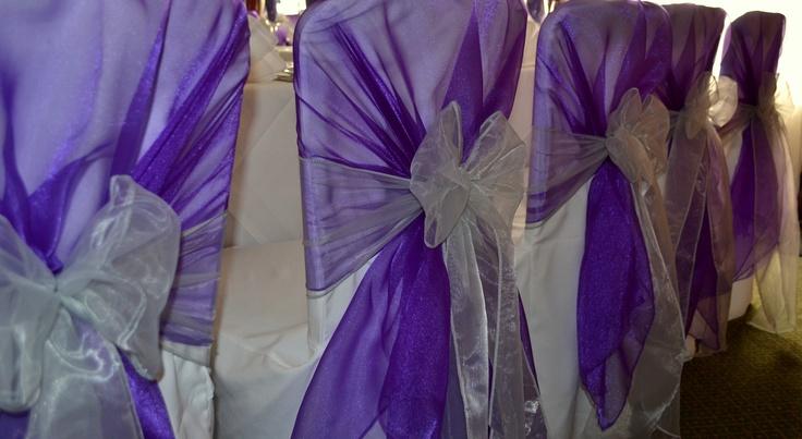 Cadburys Purple Organza Shawl and Platinum Organza Bows on White Chair Covers