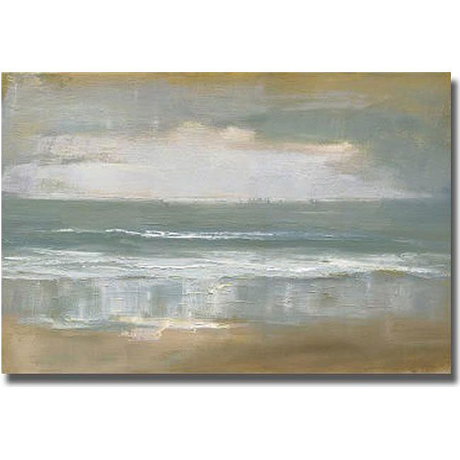 Create a tranquil mood in any room when you hang this unframed canvas art from Caroline Gold. This landscape canvas art features a shoreline rendering of waves lapping against the sands with a slightl