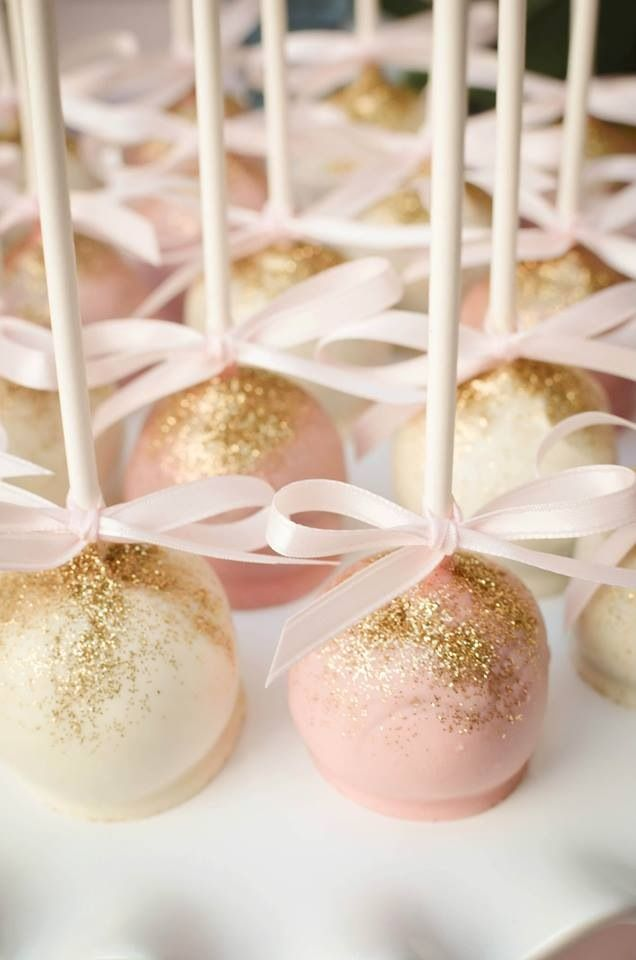 Pink and white cake pops dusted with gold edible glitter! Ribbon could take it that extra step further to look pretty