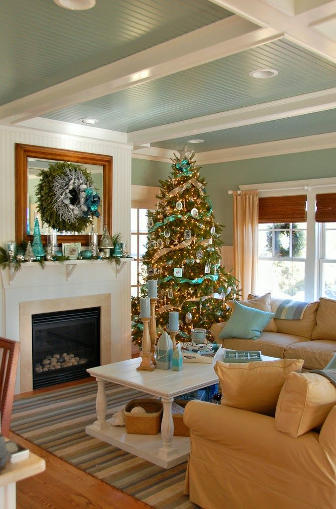 Shimmery sea-inspired Christmas decorations are a perfect fit for this coastal.: