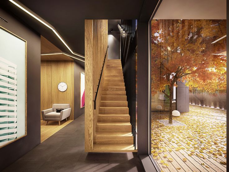 House interior. Warsaw, Poland. The beautiful view of staircase and patio with marvelous tree. Design - Plasterlina.