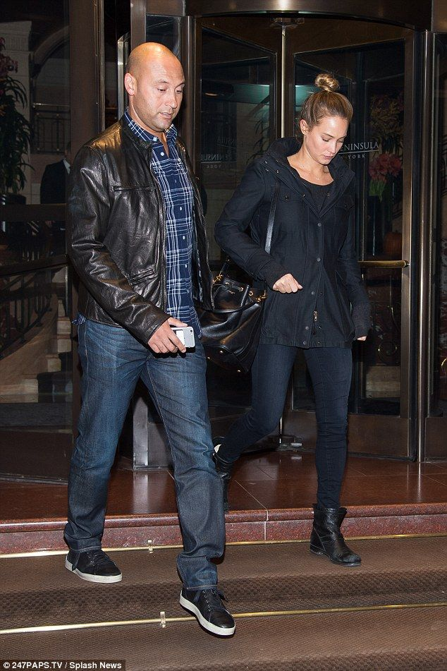 Separate plans: The pair ventured out of  the swanky midtown Peninsula hotel separately as...