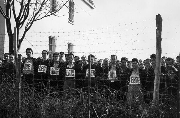 Be Careful What You Wish For   History Today    Communist fighters or sympathisers imprisoned by the Greek government at Salonika during the Greek Civil War (1946-49) await a visit by a United Nations team investigating prison living conditions in March 1947. They hold up placards spelling out in French the message 'The British Must Go', referring to the 16,000 British troops stationed in Greece.