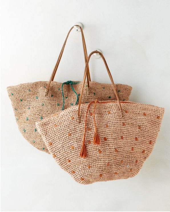 This raffia bag by Flora Bella is casual enough for the beach, yet stylish enough for the street. Nicely detailed inside with three large patch pockets.