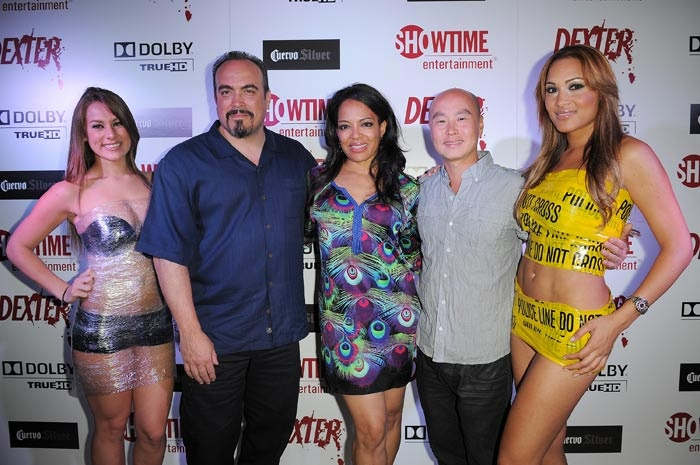 Supporting cast members David Zayas, Lauren Velez, and C.S. Lee posed for photographers on the blood-spattered white carpet.