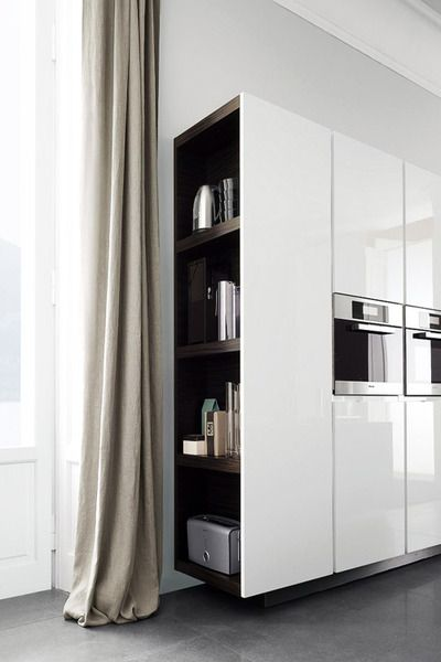 A way of ending open space kitchen -- open shelving for small kitchen accessories. White and wooden kitchen cabinets.