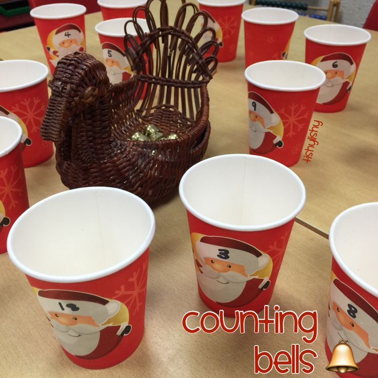 Counting bells into the numbered cups.