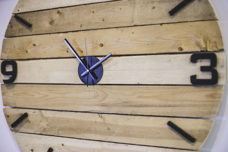 Manon Prince Interiors designed and constructed this 36 inch wide clock using wood palettes!