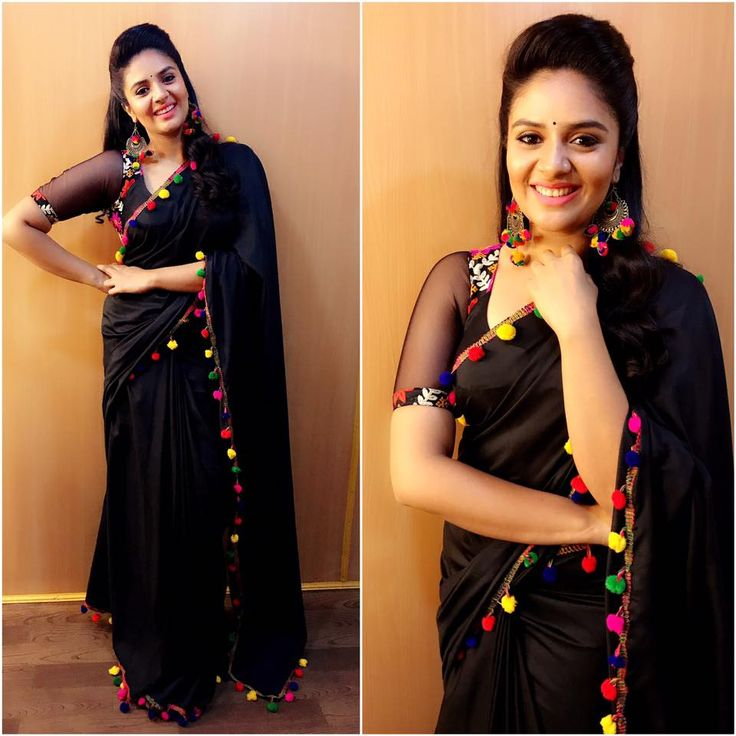 Beautiful Sreemukhi in black color designer saree and blouse. Saree with tassels all over the boarder for Gold Rush.<br> Make up and hair Nookesh <br>Accesories by Suwarnam <br> Designer : Kirthana sunil . 16 August 2017