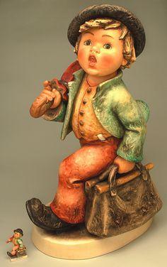 hummel figurines Jumbo Merry Wanderer shown beside 4-inch Merry Wanderer