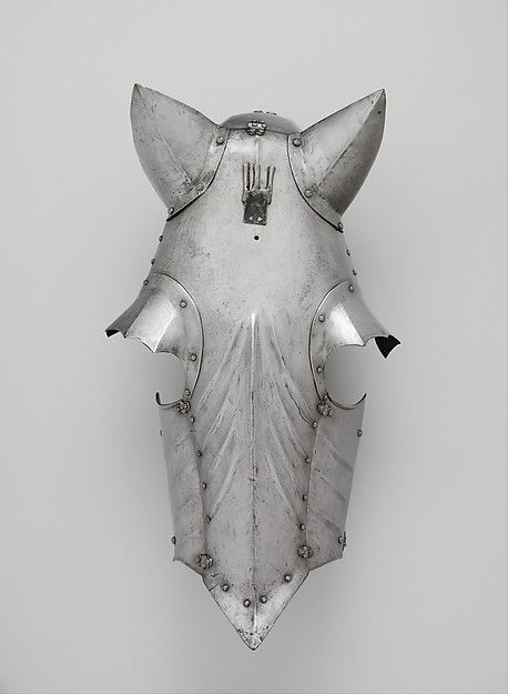 Shaffron Armorer: Attributed to Romain des Ursins (Italian, Milan, recorded in Lyon 1493–95) Date: ca. 1480–95; ear guards, eye guards, and plume holder, 19th century restorations Culture: Franco-Italian Medium: Steel Dimensions: L. 24 7/8 (63.2 cm); W. 13 in. (33 cm); Wt. 4 lb. 4 oz. (1918 g)