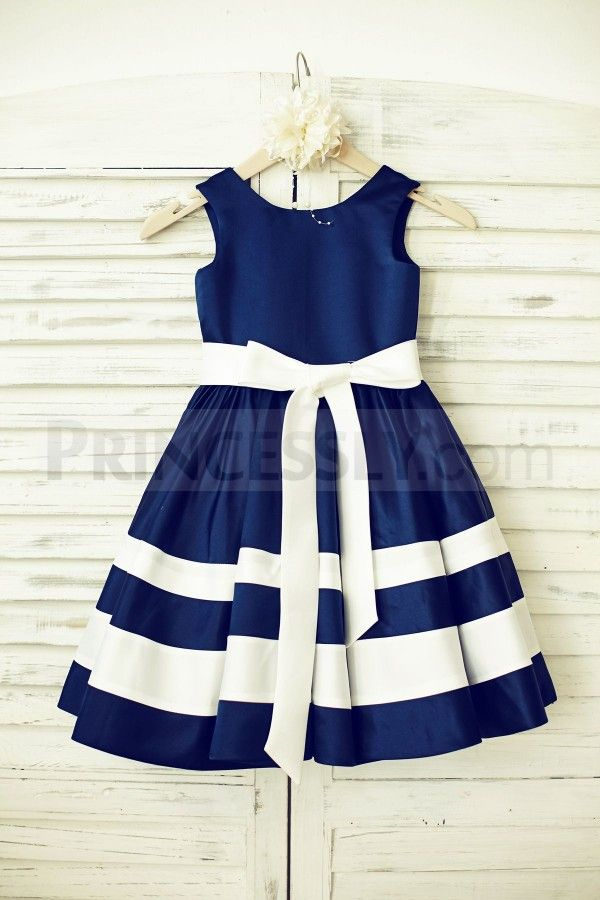 Have your flowergirl embody the nautical theme of your wedding in a dress that's slightly different - blue and white sailor stripes
