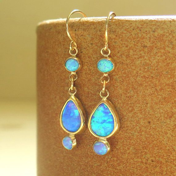 FREE SPECIAL DOOR-TO-DOOR DELIVERY!  ♥ These are a pair of lovely dangle blue Opal earrings, made of solid 14k gold.  Length: 25 mm  classic earrings with blue Opal stones , perfect for everyday and also for an amazing evening look.   come in a beautiful jewelry gift box.   AMAZING also as a gift for HER- tell us if you want to send it as a present.  For more gold earrings click here: https://www.etsy.com/il-en/shop/AditaGold?section_id=18862358   all our jewelry are made of 14k gold a...