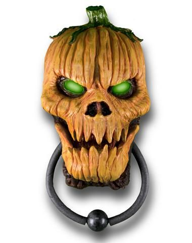 Pumpkin Door Knocker at Spirit Halloween - Set the tone of the night before your guests even enter your house when you decorate with this Pumpkin Door Knocker. This not so cute pumpkin features green light-up eyes and speaks three phrases. Get this must-have for $34.99.