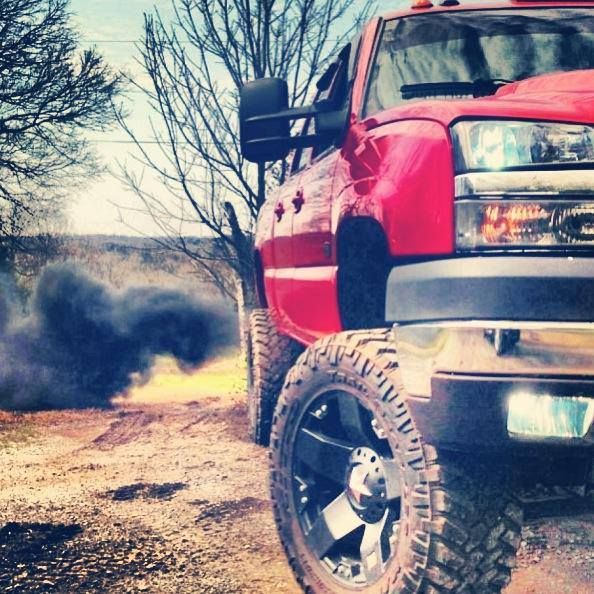 Red Chevy DuraMax. I'd never drive red vehicle, too much attention from cops, but it's beautiful!