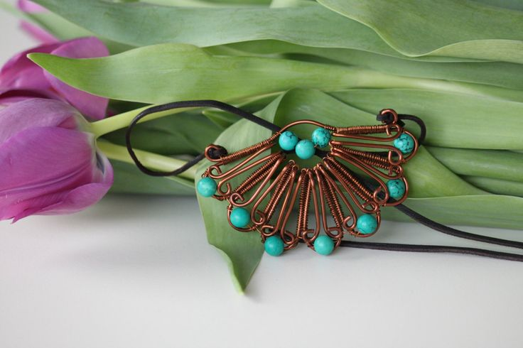 Copper wire wrapped flower pendant with turquoise beaded leaves by DeaJewelleryStore on Etsy