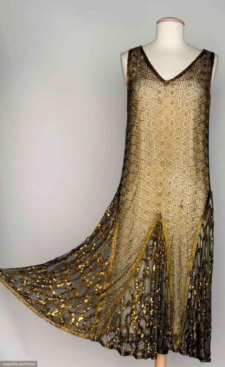 BEADED DANCE DRESS, 1920s. Beige net w/ allover geometric pattern in gold beads, gold sequin trim