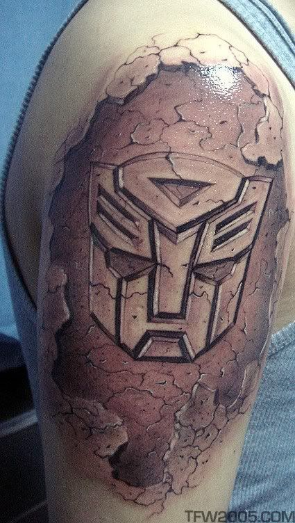 Transformers tattoo I love this! Omg this is freaking awesome