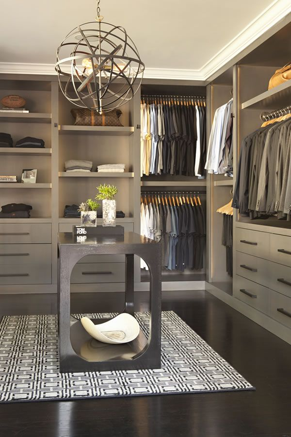 Beautiful cabinetry and muted tones make this a wonderful walk-in robe. #walkinrobes #closet