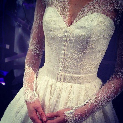 wedding dress stunning detail. exactly what ive been looking for. lace sleeves and a sweetheart neckline
