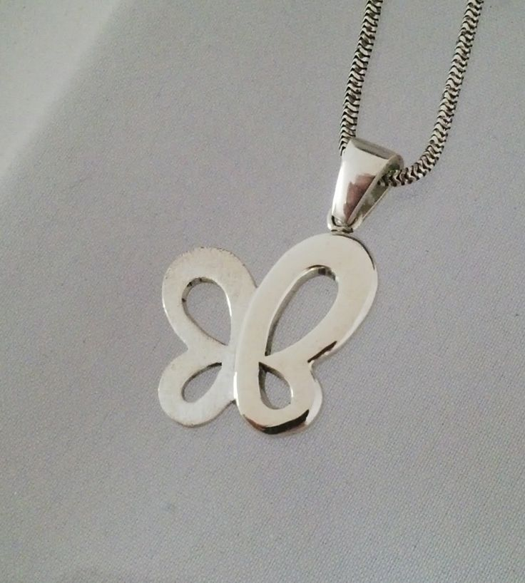 Sterling silver butterfly pendant. This pendant has a combination of gloss and matt finish to create depth to the design.