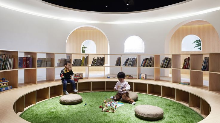 "Huge arched doorways lead to cosy wood-lined reading nooks in this children's library in Shanghai, China, designed by Muxin Studio to be like a ""giant toy""."