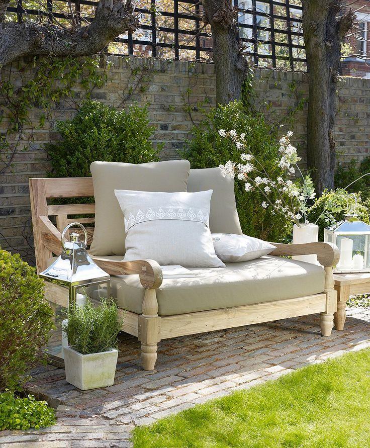 Beautiful teak outdoor furniture int the garden