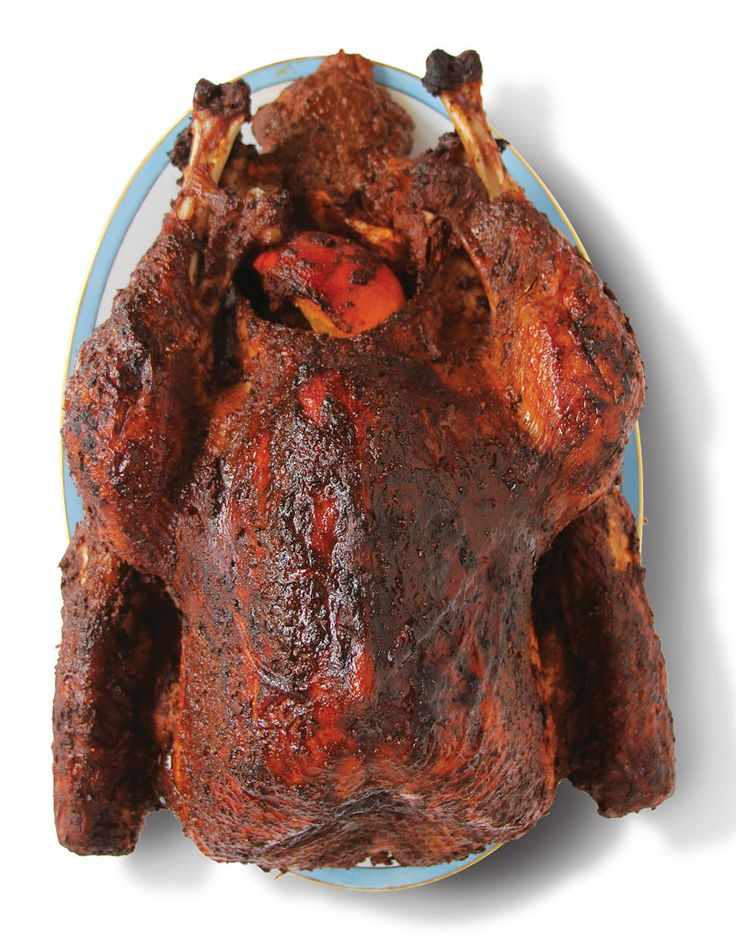 Roasted Turkey with Achiote Citrus Marinade Recipe | SAVEUR - Achiote paste gives the rub for this recipe a deep red hue, making for a visually striking roast holiday bird. This recipe was developed by chef Mary Sue Milliken