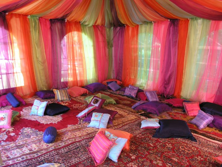 Party and event flowers | Aladdin theme child's birthday party | tent draped in sheer colorful fabric | custom pillows for seating | Westchester New York | Bedford Village Florist