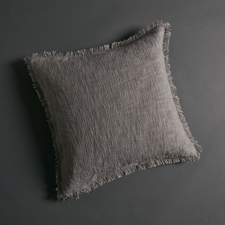 Khadi means handspun and handwoven cloth. In 1918 Mahatma Gandhi started the Swadeshi Movement for Khadi as a relief programme for the poor living in India's rural villages. This beautiful handspun, handloomed Khadi cotton cushion by Cloth&Co has been produced based on these Gandhian ideologies by traditional women weavers in rural Indian villages. Super soft to touch, this cushion cover is also available in Black and Natural, and as a beautiful Tassel Throw – links below. Handmade N...