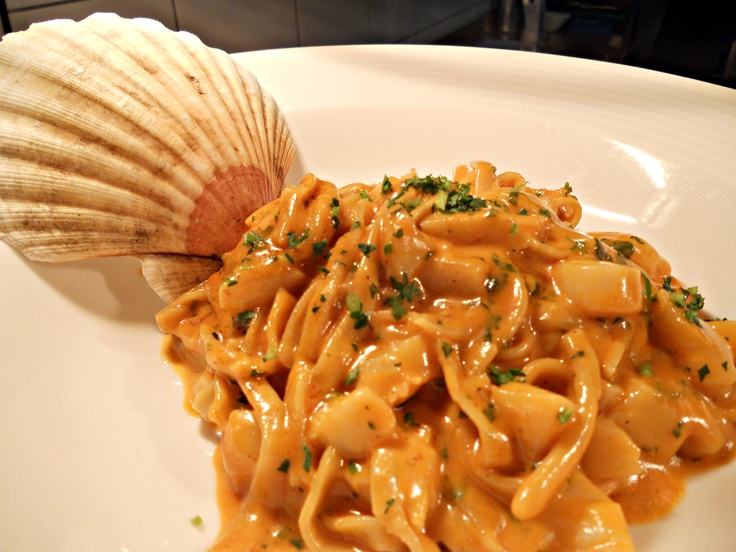 Fettucine with Saint Jacques scallops flamed in cognac and shellfish sauce