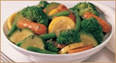 Fresh Steamed Vegetables    Tender, steamed broccoli, carrots, zucchini, yellow squash and green beans tossed in olive oil, salt and pepper.