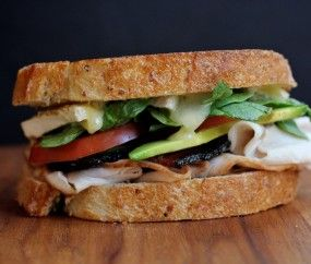 Ultimate Club Sandwich- Crisp Bacon, Whole Grain Mustard, Ripe Tomatoes, Baby Spinach, Roasted Turkey and Ripe Avo.