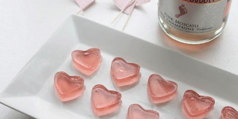 Place 10 oz of the champagne in a sauce pan and then sprinkle gelatin on top. Let gelatin soften for about 2 minutes. Turn on the heat (medium heat) and stir with a fork or whisk until the gelatin dissolves. ...#champagne #jelly shots.