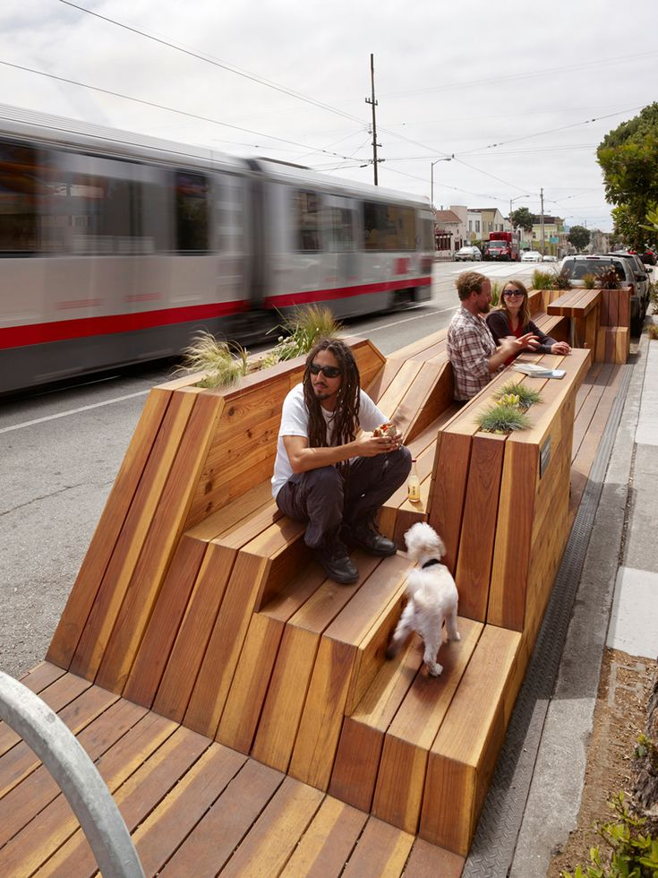 """Sunset Parklet"" is inspired by San Francisco's hilly typography. The structure's miniature up and down-hills create a dynamic public space, complete with bike parking, seating, tables, and planters. #LQC #Placemaking #StreetsAsPlaces #Parklet"